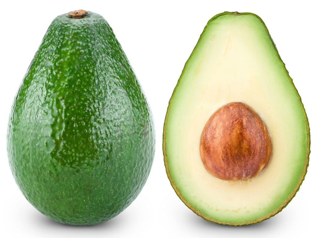 Avocado cut in half isolated on white